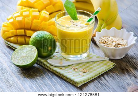 Yellow Smoothie In Glasses With Mango, Lime, Rolled Oats