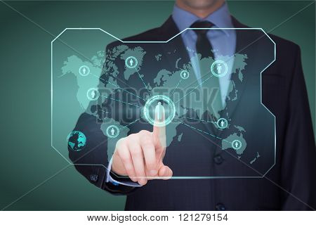 handsome businessman touching a world map on the screen showing global connection between different