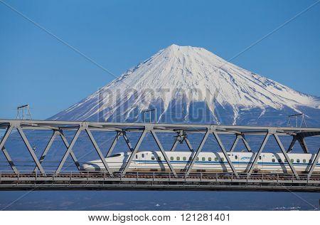 Shizuoka - JAN 13: Shinkansen bullet train and Mountain Fuji on JAN 13 ,2015 , Shizuoka ,Japan. Shinkansen is world's busiest high-speed railway operated by four Japan Railways companies.