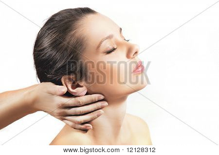 Plastic surgery touching the head of a beautiful female face