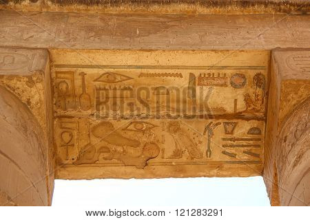 Ancient Egyptian hieroglyphs carved on the stone. The roof of the temple at Karnak.