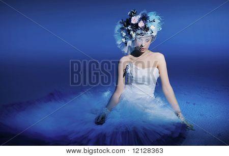 Beautiful brunette wearing flowers hat