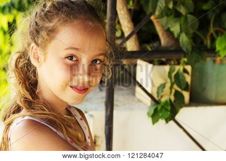Portrait of beautiful teen girl relaxing at the garden