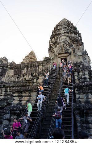Siem Reap, Cambodia - December 4, 2015: Tourists Climb To A Praying Tower At Angkor Wat