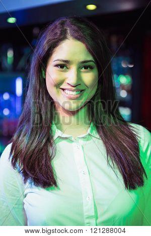 Portrait of pretty bartender at nightclub