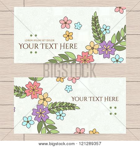 Vector design of business cards with Japanese flowers and leaves.