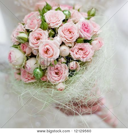 Wedding bouquet with pink roses in bride hand