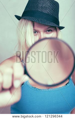 Female Detective With Magnifying Glass