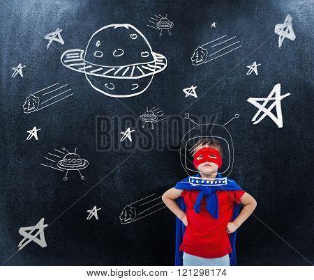 Masked boy pretending to be superhero against black background
