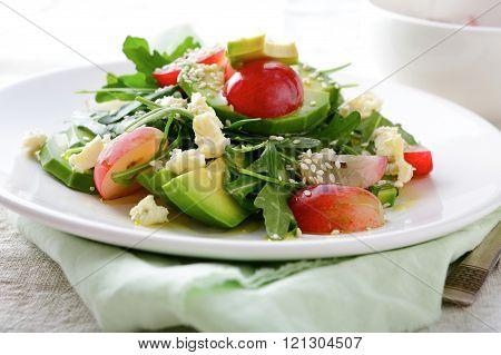 Light Avocado Salad With Grape, Arugula And Cheese