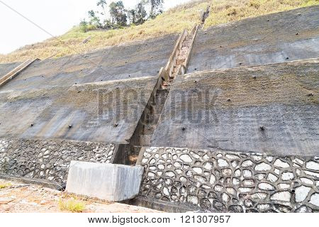 Slope and earth retention wall along hilly terrain in tropical environment