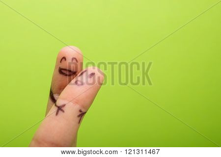 Funny finger holding blank bunner and smiling