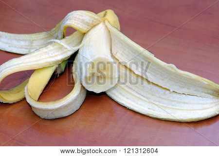 Half Eaten Peeled Banana With The Peel
