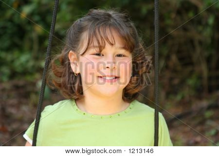 Little Girl On Swing