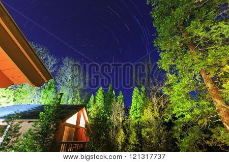 Wooden House With Star Trail