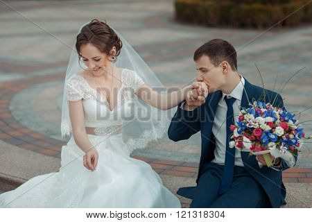 Groom Kisses The Hand Of  Bride