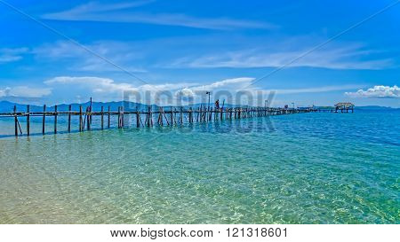 Wooden pier stretching out to sea (Indonesia)
