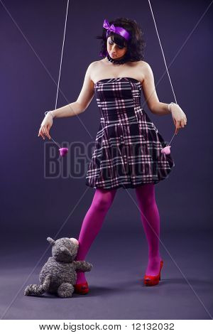 Beautiful woman stylized as mannequin marionette