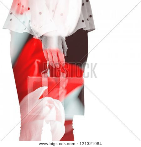Cropped image of woman holding book belt against tulips with note