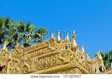 Myazedi pagoda golden ornament on blue sky background. Bagan. Myanmar.