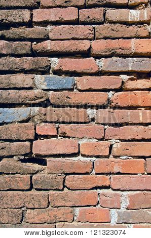 An old red brick wall in Bagan (Myanmar).