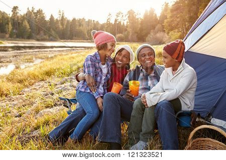 Grandparents With Children Camping By Lake