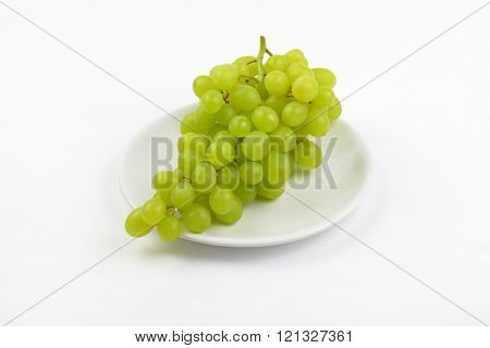 bunch of white grapes on white plate