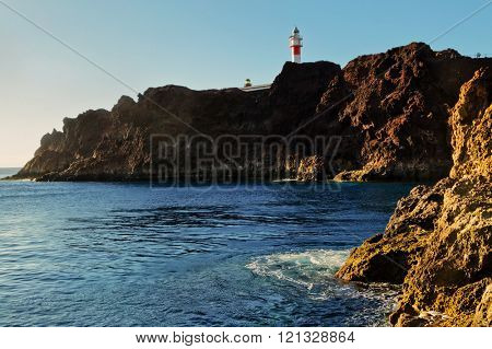 View of sea and cliffs with a Punto Teno lighthouse.Tenerife. Canary Islands. Spain