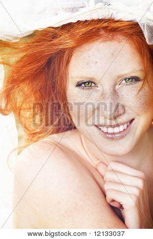 Sunny portrait of readheaded girl