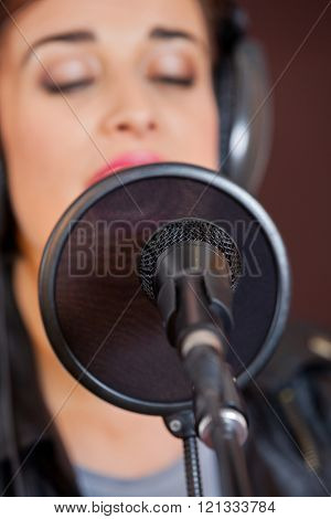 Mike And Condenser With Woman Singing In Studio
