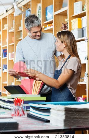 Saleswoman And Customer Holding Greeting Card