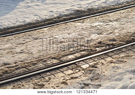 Tram-lines With A Snow
