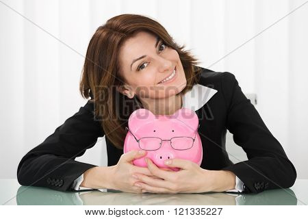 Businesswoman Holding Piggybank
