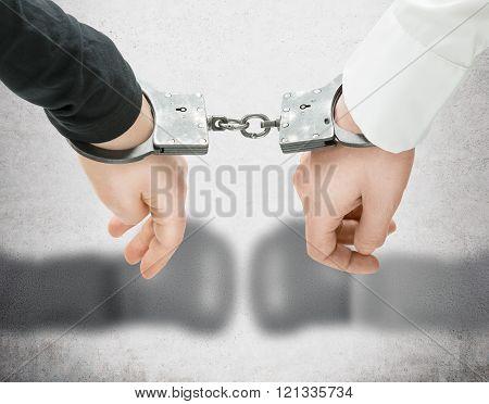Hands In Handcuffs.