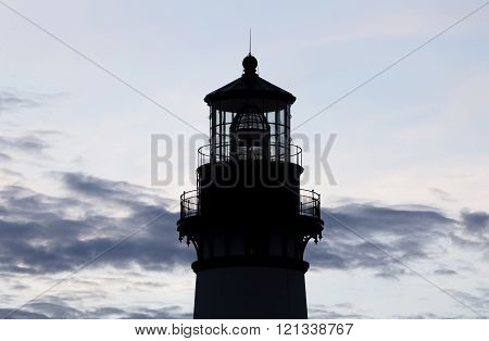 Yaquina Bay Lighthouse Silhouette Against Cloudy Sky