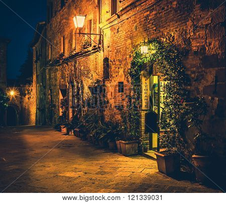PIENZA, ITALY - JUNE 26, 2015: Small cosy restaurant in old Pienza town Tuscany
