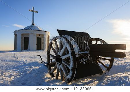 A cannon from Monte Grappa first world war memorial Italy. Winter panorama from italian alps