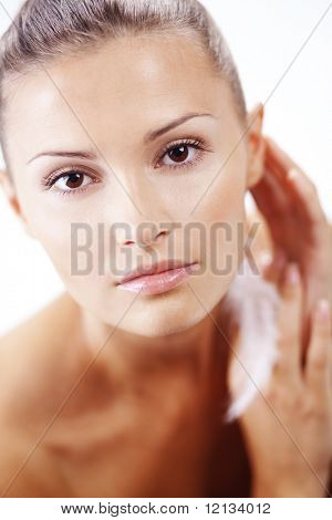 Beautiful female with clean healthy skin closeup over white