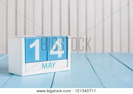 May 14th. Image of may 14 wooden color calendar on white background.  Spring day, empty space for te
