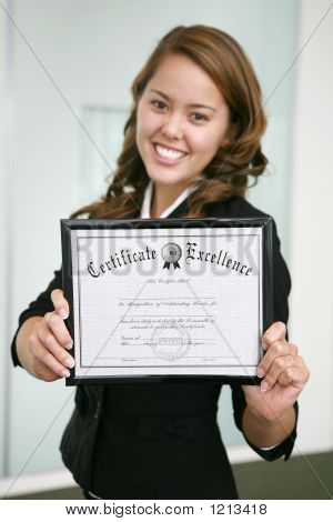 Business Woman With Certificate (Focus On Certificate)