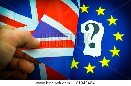 Brexit UK EU referendum concept with hand turning flag and revealing question mark
