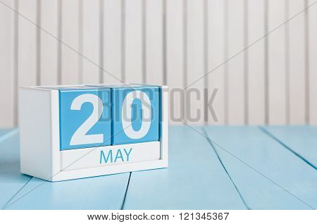 May 20th. Image of may 20 wooden color calendar on white background.  Spring day, empty space for te