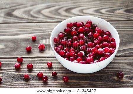 Frozen cranberries on the wooden table