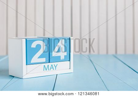 May 24th. Image of may 24 wooden color calendar on white background.  Spring day, empty space for te