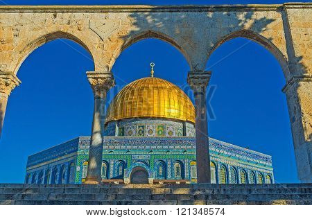 The view on the Dome of the Rock through the Scales of Souls colonnade Jerusalem Israel.