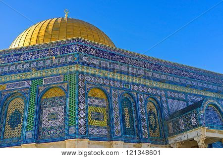 The Dome of the Rock decorated with colorful glazed tiles covered with geometric islamic patterns and Quranic calligraphy Jerusalem Israel.