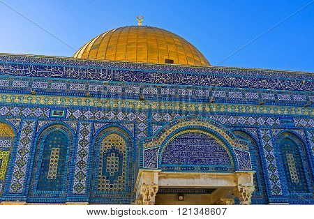 The glazed tiles of the Dome of the Rock are mostly in shades of blue color Jerusalem Israel.