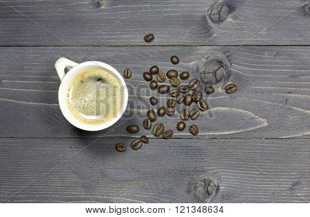 Cup Of Coffee And Coffeebeans