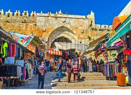 JERUSALEM ISRAEL - FEBRUARY 16 2016: The view on Damascus Gate from Arab Souq the famous place among tourists and locals on February 16 in Jerusalem.