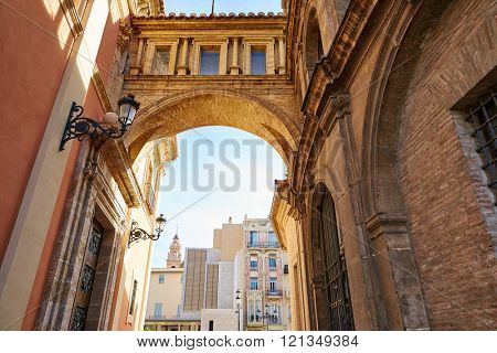 Valencia Plaza Virgen square with cathedral arch in Spain